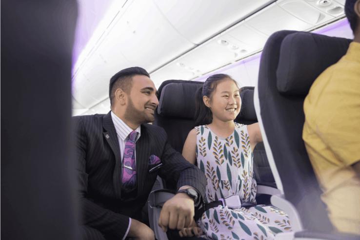 Onboard-Flight-Attendant-helping-child-4316-1200x800