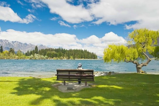 Lady sitting by lake, Queenstown.