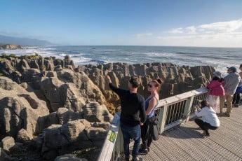 A couple viewing Pancake Rocks, New Zealand.