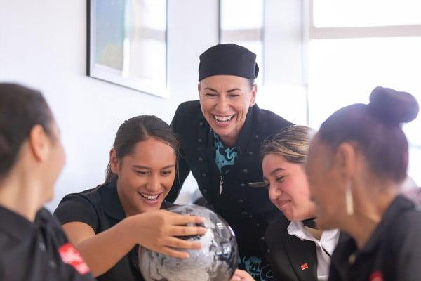 Queenstown Resort College students with Air NZ employee.