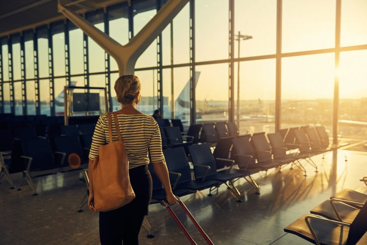 Woman walking with baggage.