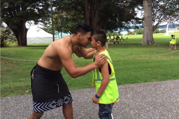Hedgehope School student performing hongi with cultural leader at Waitangi Treaty Grounds